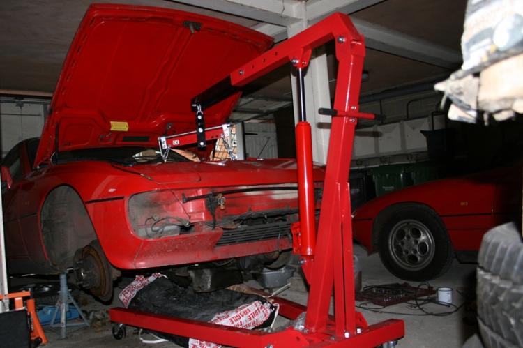Porsche 924 S 2.5l Engine being lowered on a hoist